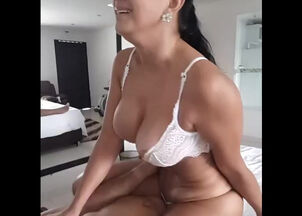 Busty milf rides cock